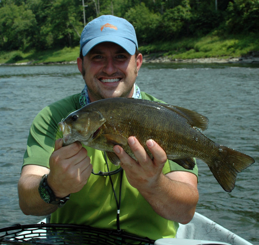 Bart Larmouth holds a 4.5# Smallmouth. Photo: Jeff White