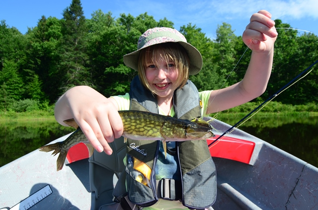 Delilah with her first fish on a fl rod on her first day casting!  Photo by Bob Lewis