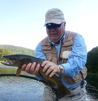 Bill with a nice brown on the Main.  Photo by Jim Swift