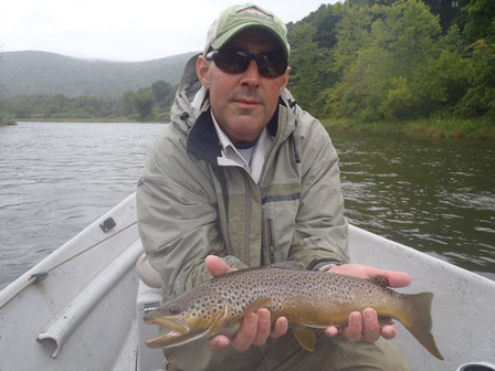 Steve with a West Branch brown trout.  Photo by Bruce Miller