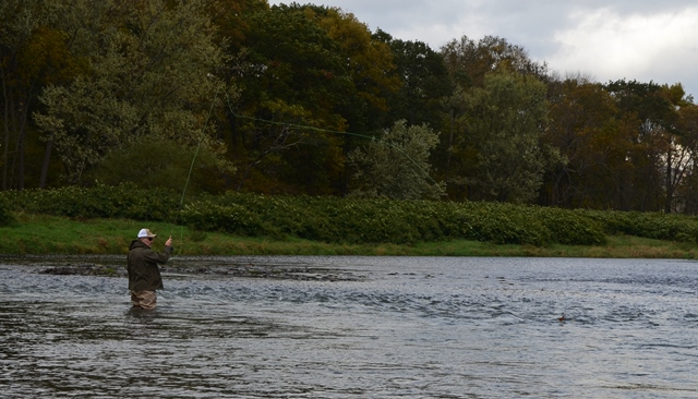 artist Flick Ford getting some casts in before the rain hit this week