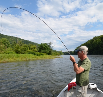 Tony fighting a nice fish on the West Branch yesterday