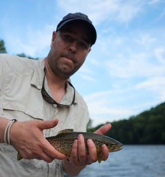 Steve with a pretty red spotted brown.  Photo by Jared Makowski