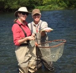 Cristen with her first fish on a fly!  Photo by Jim Brinkerhoff