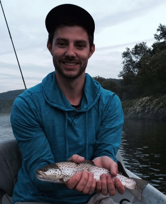 Rich with his first fish ever on a fly rod.  Photo by Samantha Dennis