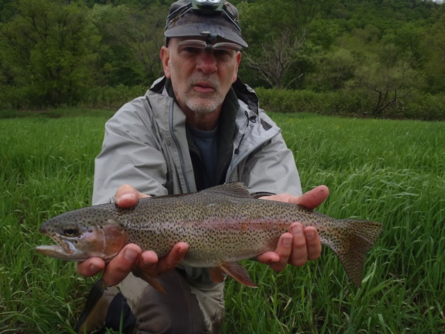 Louis with a nice rainbow.  Photo by Bruce Miller