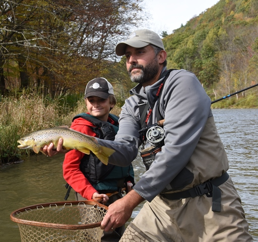 Steve and Ethan with a West Branch fish.  Photo by Bob Lewis