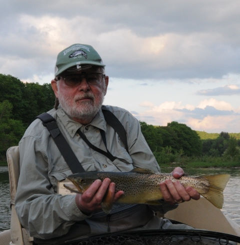 Jim with a nice evening fish.  Photo by Samantha Dennis