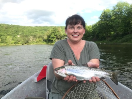 Lori with her first fly rod fish.  Bob Lewis photo