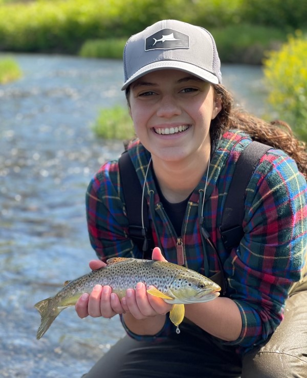 Catherine with her first Delaware trout.